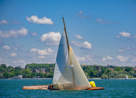Swedisch racing boat going upwind in front of city line