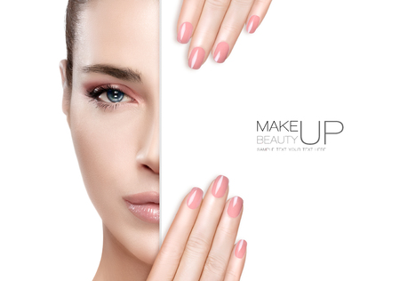 Photo pour Beauty Makeup and Nai Art Concept. Beautiful fashion model woman with soft pink smoky eye makeup, foundation on a unblemished skin and trendy pink lipstick to match her manicured nails, half face with a white card template. High fashion portrait isolated  - image libre de droit