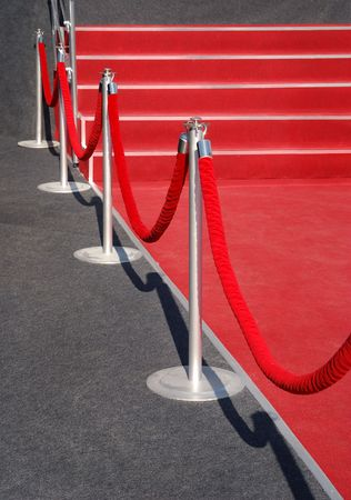 Portable Barrier for Queue Control. Red security rope by red carpet. event object
