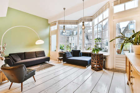 Photo pour Elegant and spacious living room with beautiful furniture - image libre de droit