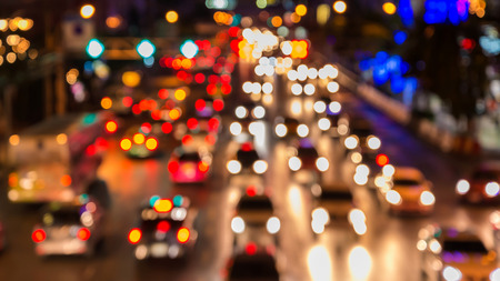 Foto de abstact blur bokeh of Evening traffic jam on road in city. - Imagen libre de derechos