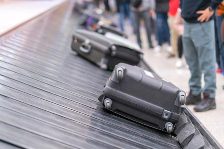 Foto für Suitcase or luggage with conveyor belt in the airport. - Lizenzfreies Bild