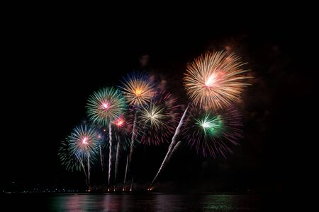 Photo for Colorful fireworks of various colors at night with celebration and anniversary concept. - Royalty Free Image