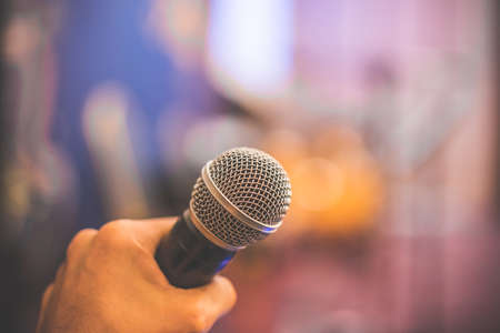 Photo pour hand hold Microphone in meeting room for a conference. - image libre de droit