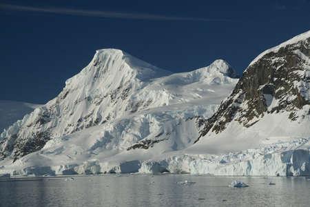 Mountains & glaciers with icefalls emptying into the ocean,,Neko Harbor, Andvord Bay,Antarctica