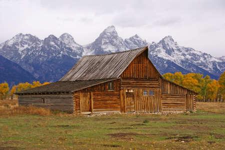 Autumn, Grand Tetons and old western farm buildingsMormon Row,Grand Teton National Park,Wyoming
