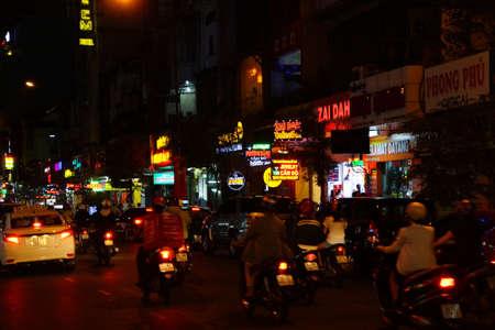 SAIGON - FEB 4, 2015 - Motorbike traffic at night in Central Saigon Vietnam