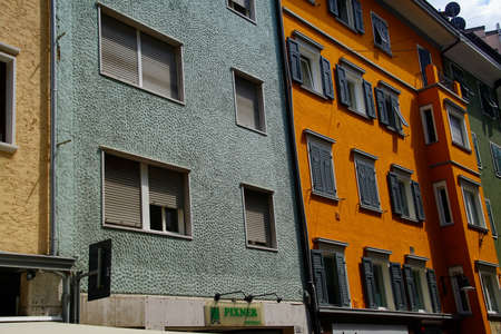 BOLZANO, ITALY - JUL 26, 2018 - Pastel buildings on arcaded street of Bolzano, Italy