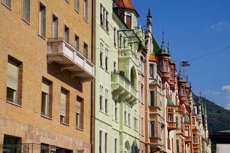 Pastel buildings on arcaded street of Bolzano, Italy