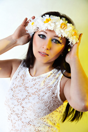 Portrait of  beautiful girl with daisy wreath