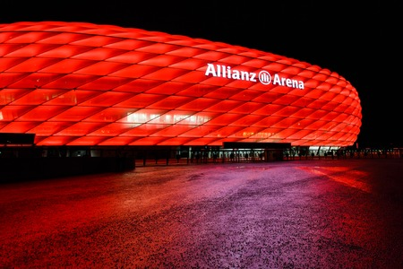 Munich, Germany - January 05 2016: View of the red color Allianz Arena at night time, is a great football stadium in the city with a 75,024 seating capacity