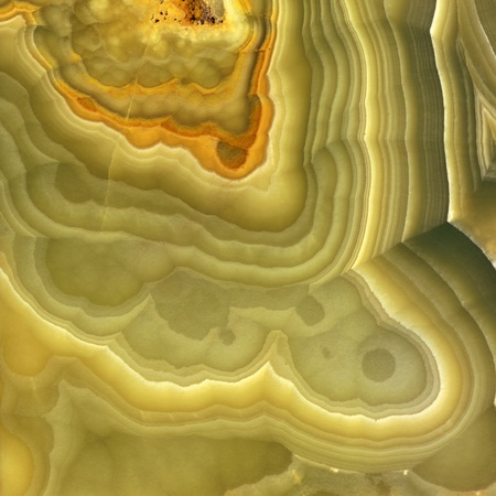 Magnified image details of a layer of onyx, green, yellow and orange