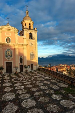 Vezzano Ligure - Church of Nostra Signora del Soccorso (16th century), the village and the Apuan Alps. La Spezia, Liguria, Italy, Europe