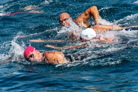 TELLARO, GULF OF LA SPEZIA, LIGURIA, ITALY - JULY 21th, 2019: Swimming competition in the Mediterranean sea (Trofeo del Gro), in front of the ancient village of Tellaro, Liguria, Italy, Europe
