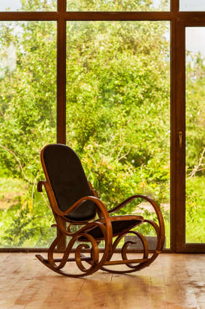 Vintage rocking chair near a large window