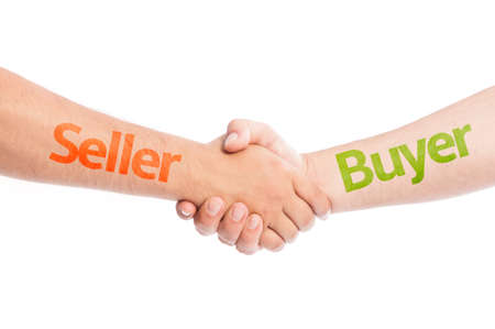 Seller and Buyer shaking hands. Commerce trade concept usig hand shake isolated on white background.