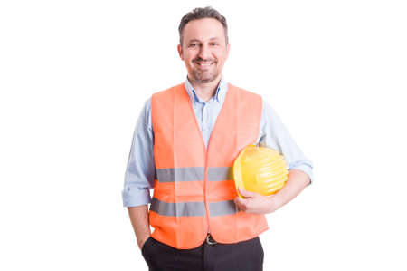 Proud, confident and successful contractor, foreman or builder wearing vest and yellow helmet