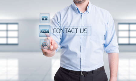 Contact options in digital futuristic concept with hand pressing button on transparent digital screen