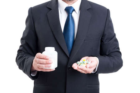 Medicine sales representative holding pills and bottle