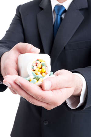 Medicine sales man rep offering pills by puring them in hand