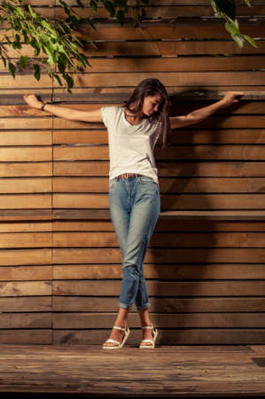 Foto de Fashionable and religious concept with female model wearing t-shirt and jeans - Imagen libre de derechos