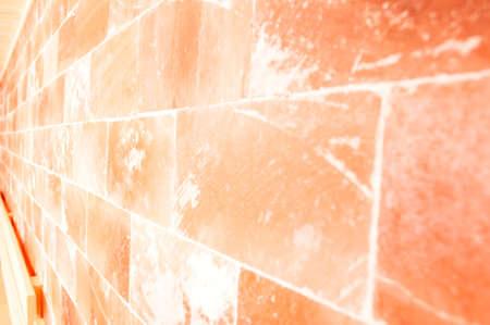 Closeup of himalayan salt wall in sauna room as  textured concept