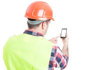 Photo for Backview of male engineer holding mobile phone with blank screen and copyspace isolated on white - Royalty Free Image
