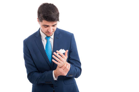 Salesman or broker having an painful injury at his wrist isolated on white background with text space