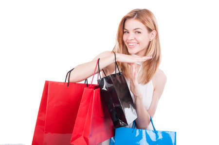 Cheerful woman with colored paper bags doing time out gesture as shopping break conceptの写真素材