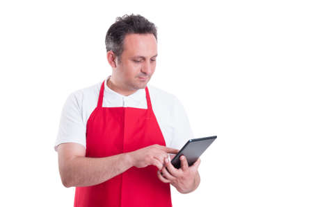 Young store supervisor with tablet pc in hand checking the product stock