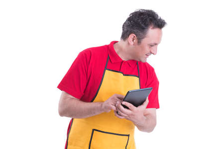 Male seller using a digital tablet to count the product in the store isolated on white background