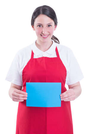 Friendly seller holding blank paper in hands and smiling on white background