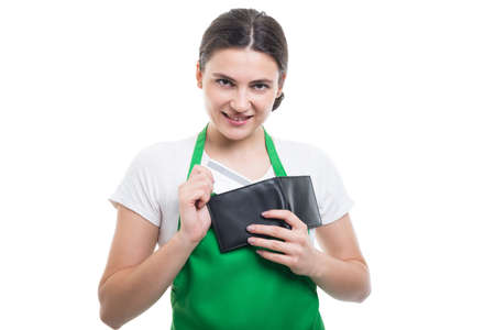 Beautiful employee girl taking out from wallet her credit card for electronic payment