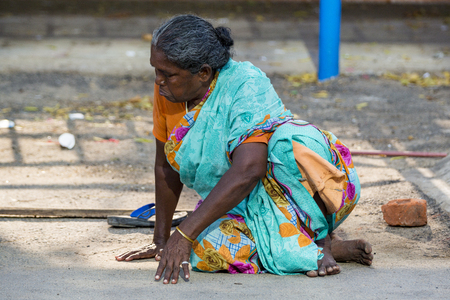 Photo for RAMESHWARAM, TAMIL NADU, INDIA - MARCH CIRCA, 2018. Portrait of an unidentified homeless woman in the street of the sacred city of Rameshwaram, India. - Royalty Free Image