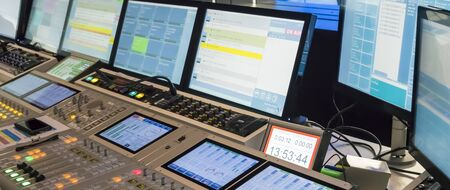 Photo pour PARIS, FRANCE- NOVEMBER Circa, 2019. Technical room with audio mixing console, computers, tv led, screens and studio equipment in recording, broadcasting, editing studiio. - image libre de droit