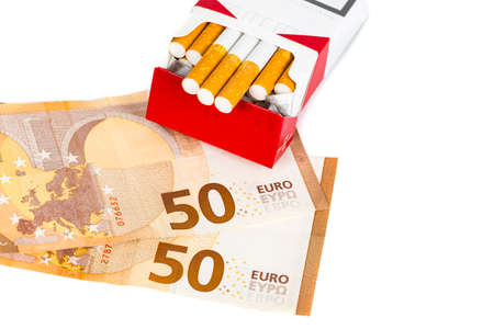 Photo pour Illustrative editorial. Euros Money notes one hundred and cigarettes box Malboro brand on white background. Concept tabacoo prices and health costs. - image libre de droit