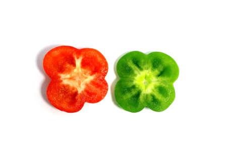 cut green and red peppers in the shape fo flowres isolated