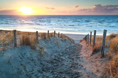 Foto de sunset over path to North sea beach, North Holland, Netherlands - Imagen libre de derechos