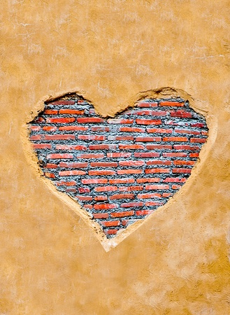 The Heart shape on brickwall background