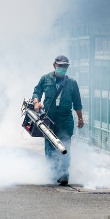 Laksi,Bangkok, THAILAND - March 11   The unidentified officer is spraying chemical for an outbreak of dengue fever on March 11 , 2014 in Laksi , Bangkok, Thailand