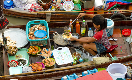 AMPAWA SAMUTSONGKRAM,THAILAND - April 19, 2014: Most famous floating market in Thailand have variety of Thai Traditional Food
