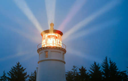Photo pour Lighthouse Beams Illumination Into Rain Storm Maritime Nautical Beacon - image libre de droit