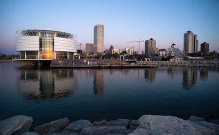 Photo for MILWAUKEE, WISCONSIN/UNITED STATES – APRIL 1: Most of the cities residents sleep as the sun comes up on the downtown waterfront on 04/01/2017 in Milwaukee, WI. - Royalty Free Image