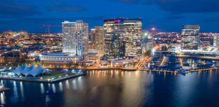 The buildings are illuminated in the downtown urban core of Baltimore Maryland