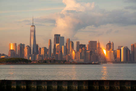 Photo pour Manhattan is one of 5 Burroughs that make up New York City shown here at sunset - image libre de droit