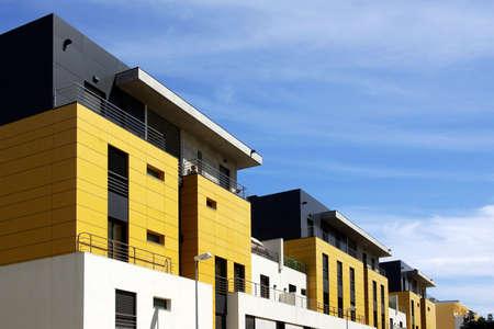 Facade of a modern apartment condominium in a sunny day