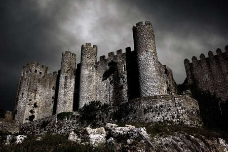 Disturbing scene with medieval castle at night with stormy sky