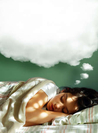 Photo pour Young girl sleeping in her bed, with a dreaming fluffy balloon above her head  - image libre de droit