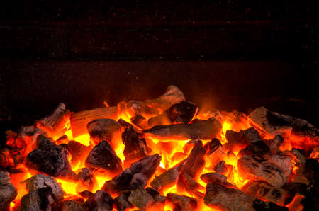 Photo for Photo of hot sparking live-coals burning in a barbecue - Royalty Free Image