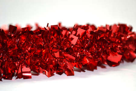 shiny red garland isolated on white background close up
